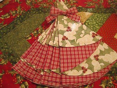 Half circle napkins folded to look like Christmas trees ...