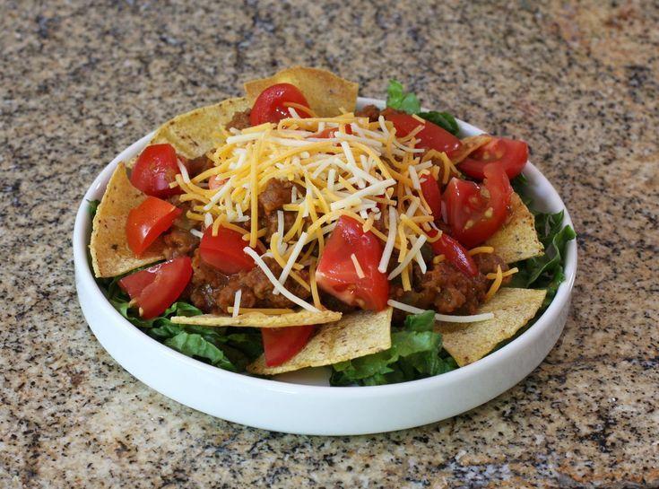 A delicious taco salad with homemade sour cream dressing