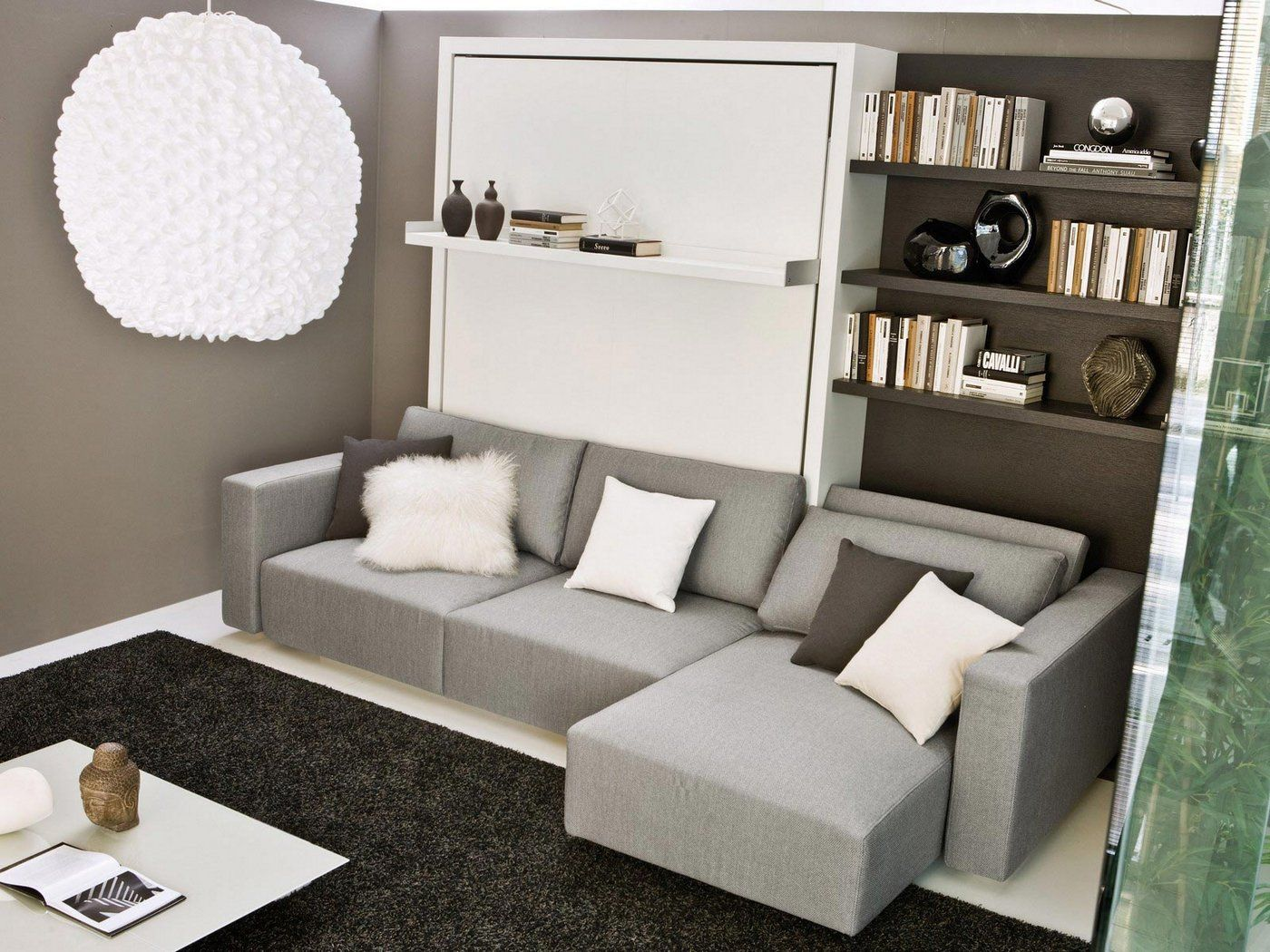 Sleek murphy bed next to open shelving small room ideas