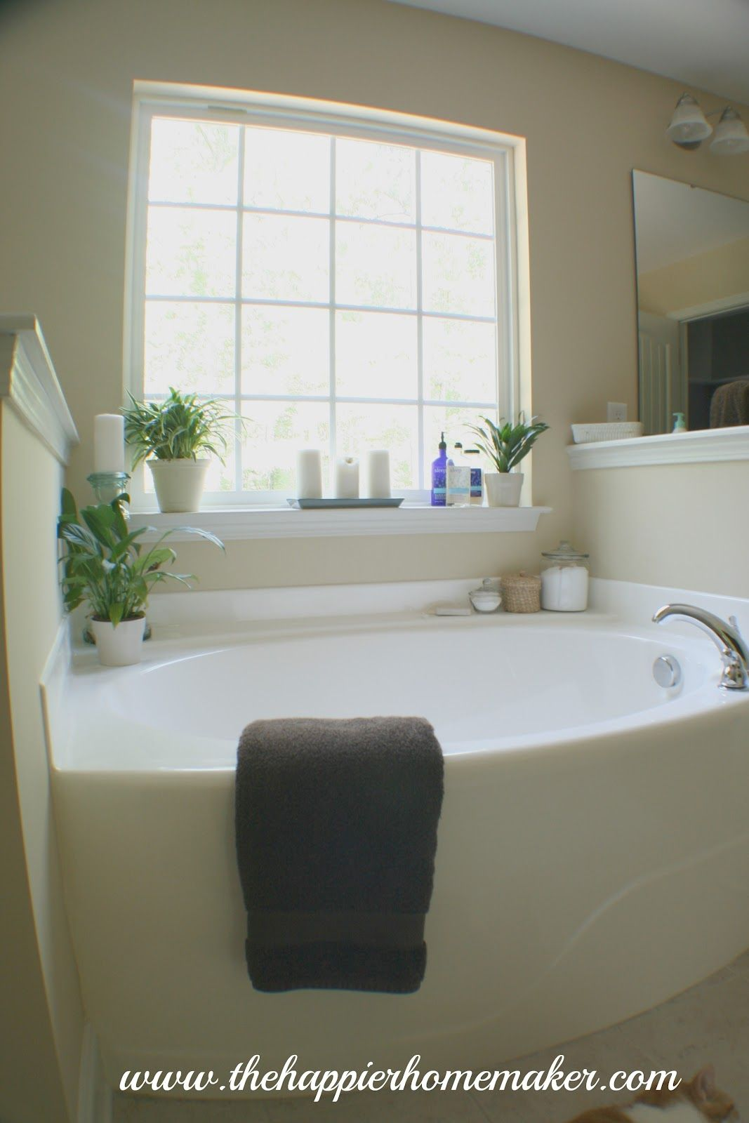 Decorating around bathtub on pinterest bathtub decor for How to decorate a garden tub bathroom