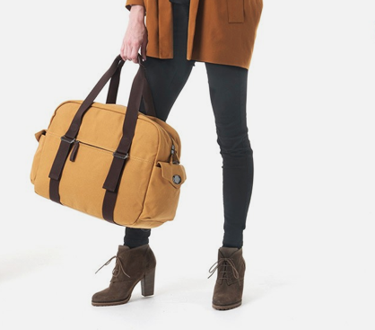 QWSTION Overnighter in Honey Mustard with 2 for 1 strap system, converting this bag into a backpack for when you are on the go!