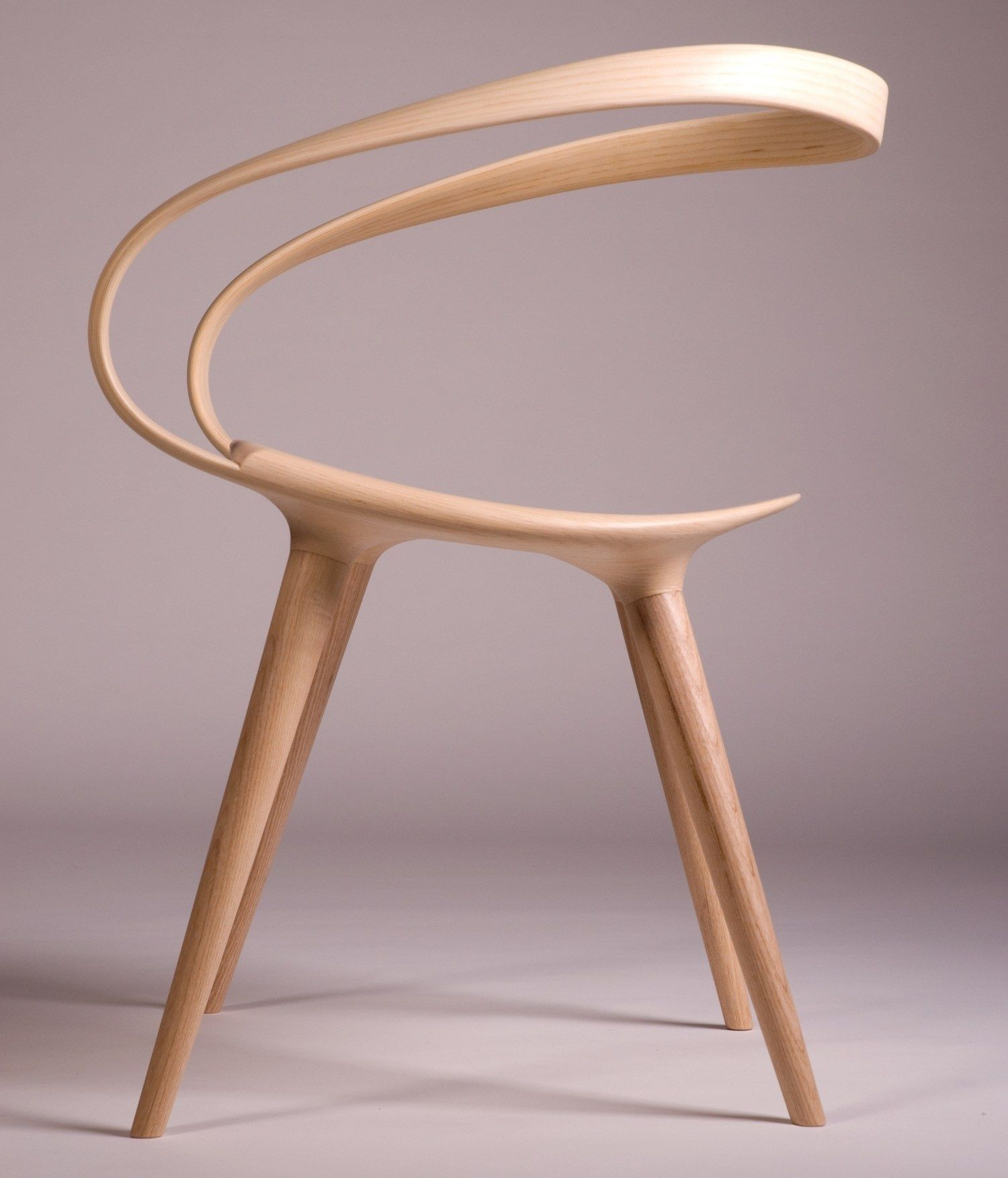 This Insane Bent Plywood Chair is Inspired by Modern Bicycle Design is part of Minimalist furniture - There's more than a handful of reasons why the humble bicycle is an object of obsession for many an industrial designer or engineer  Aside from the zillions of proportion variations, material combinations and CMF studies that go into the design process, it is also one of the few objects that can be designed for users