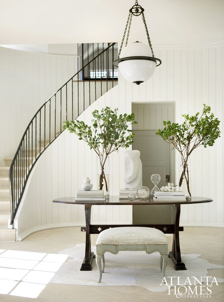 An Industrial Globe Pendant From Circa Lighting Hangs Over The Entry Table  In The Foyer,