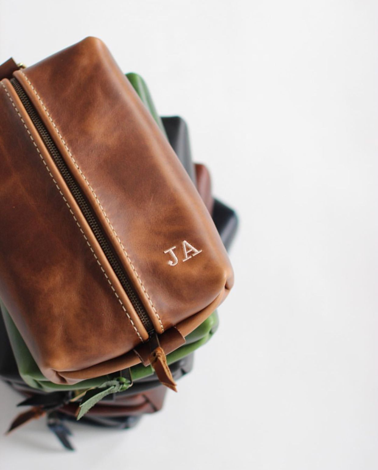 Don t mix up your toiletry bags! We can have them personalized with your  initials. Made from genuine leather designed to last you a lifetime! e51b8faea51ba