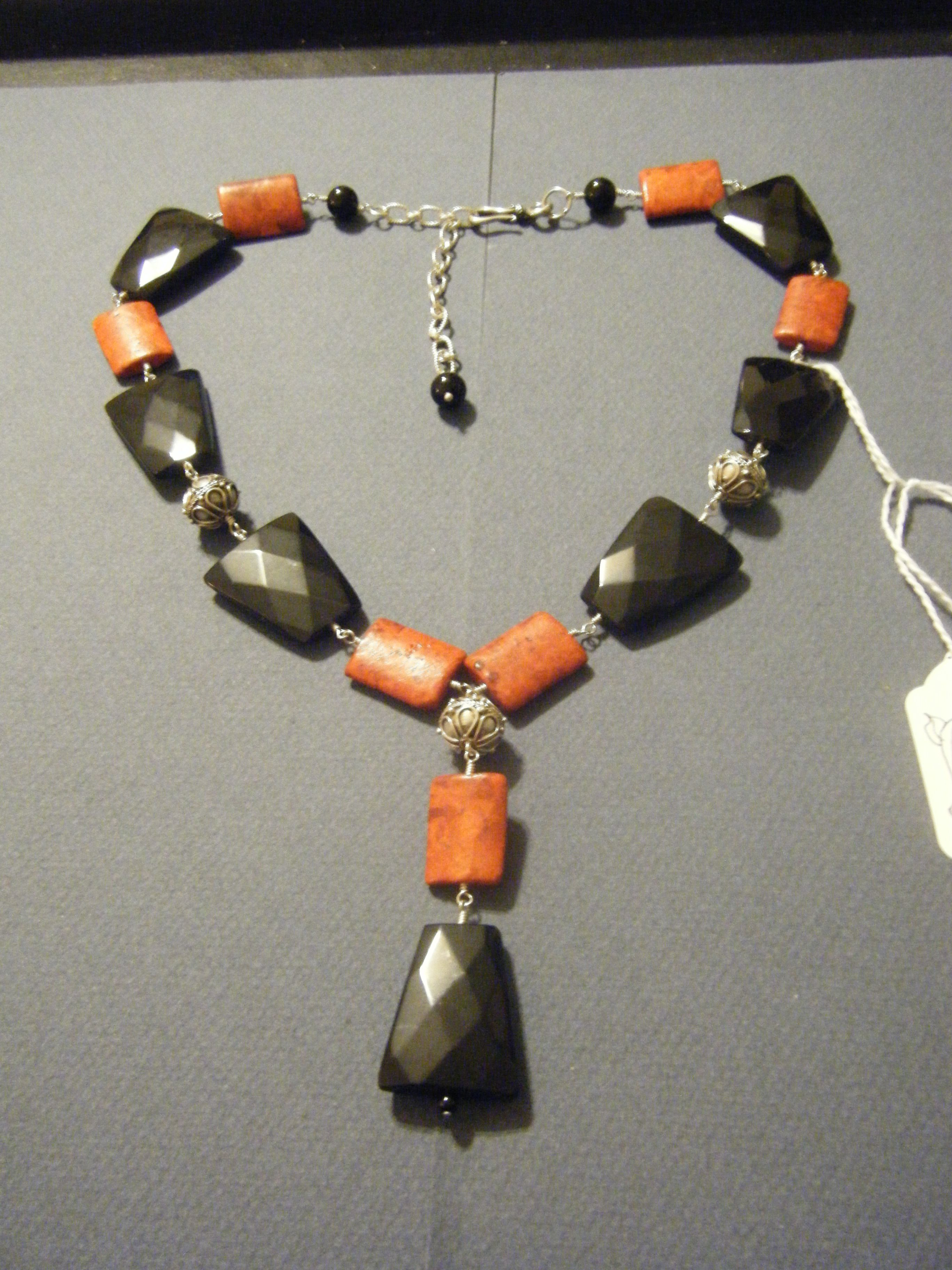 Black onyx and Sponge coral wirewrapped with Sterling Silver wire and accents
