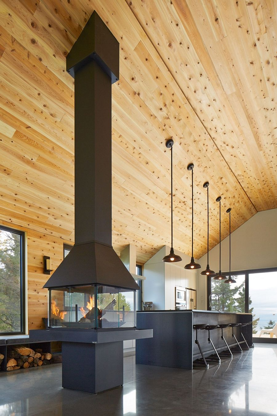 Expansive quebec residence charms with inviting warmth of wood
