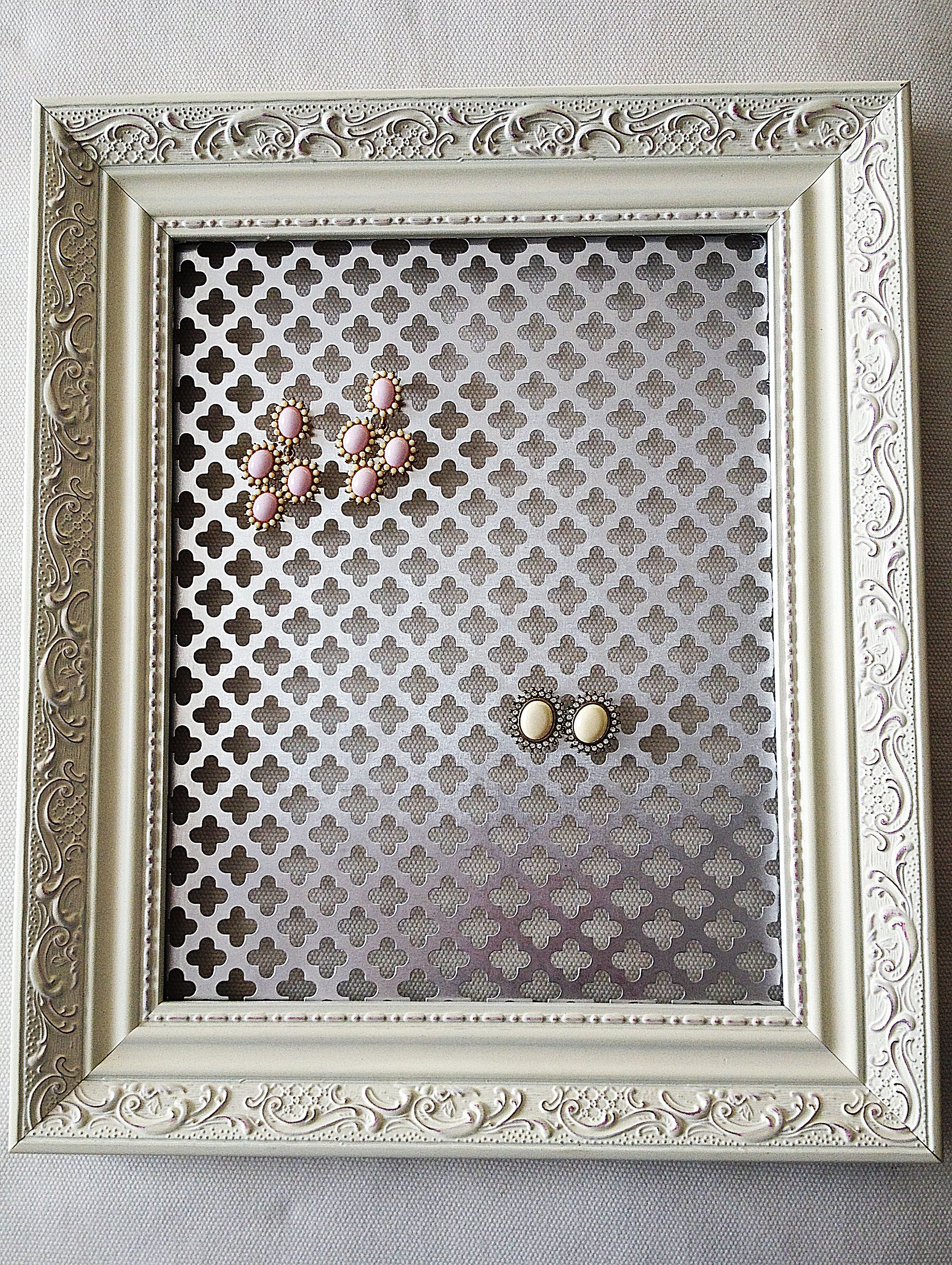 Jewelry holder made from a picture frame and hot glueing a piece of