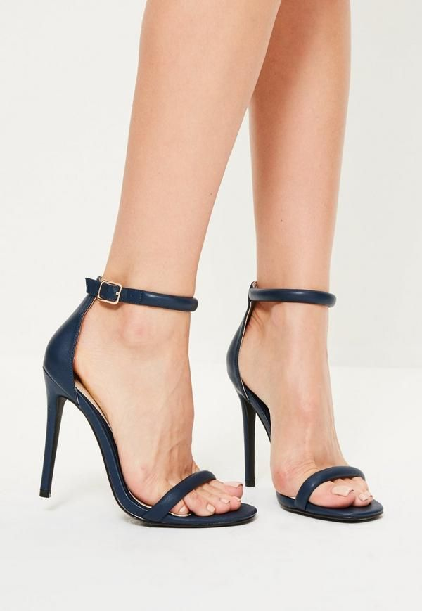 18002e6bf97 These navy strappy barely there heels are the perfect finishing touch for a  luxe outfit.