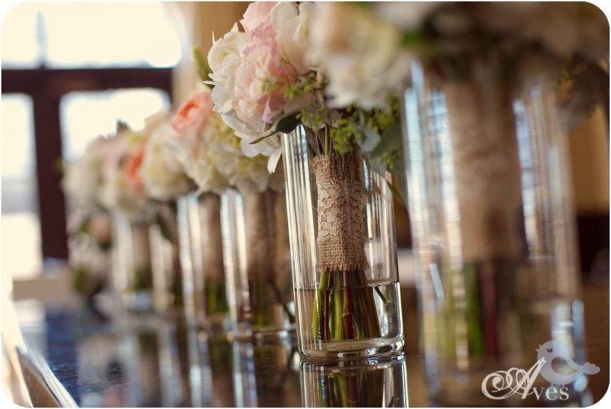 Place Empty Vases On The Head Table For Bridesmaids To Put