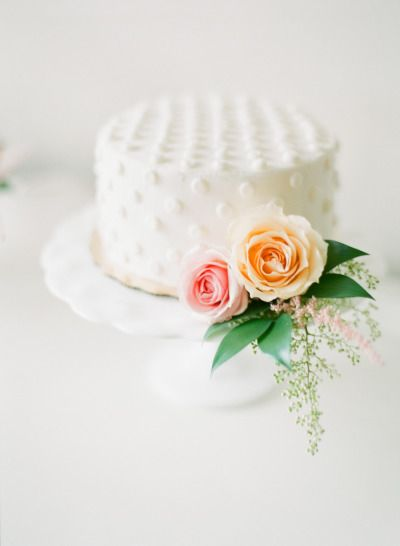 White polka dotted wedding cake: http://www.stylemepretty.com/2014/12/12/blush-pink-mountain-lodge-wedding/ | Photography: Connie Dai - http://www.conniedaiphotography.com/