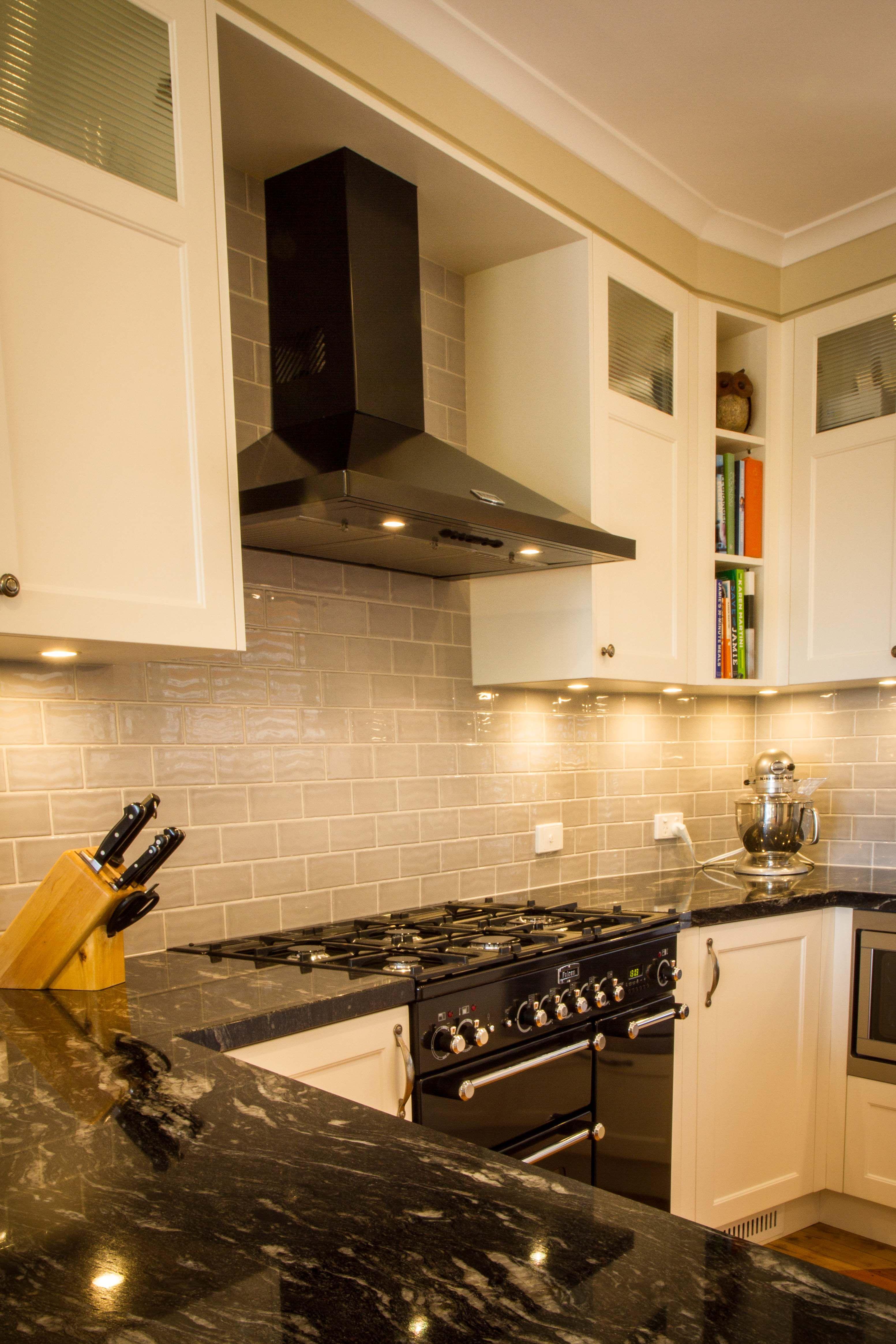Traditional kitchen. Canopy rangehood. Black rangehood. Black oven ...