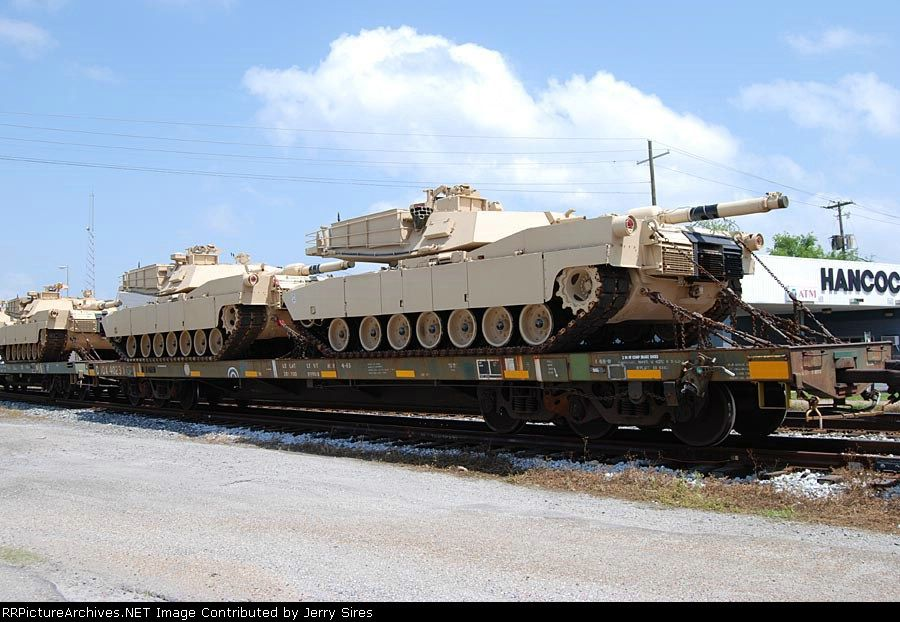 A pair of Abrams M1A1 Tanks on a military train at
