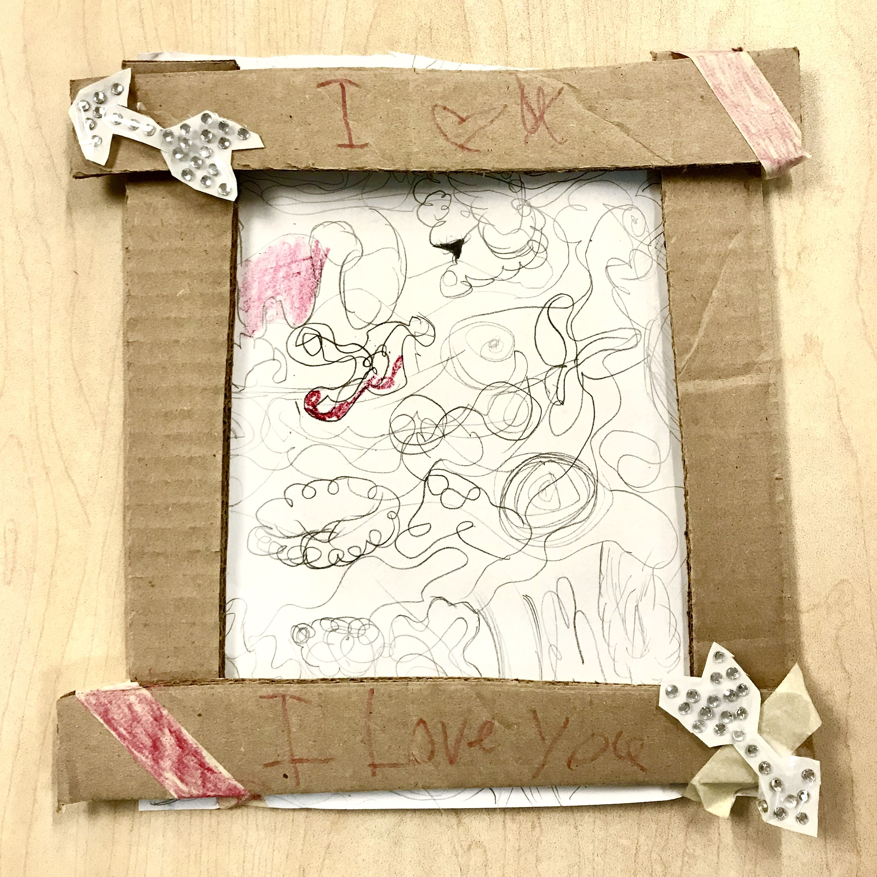 Student s cardboard sculpture of a homemade picture frame and