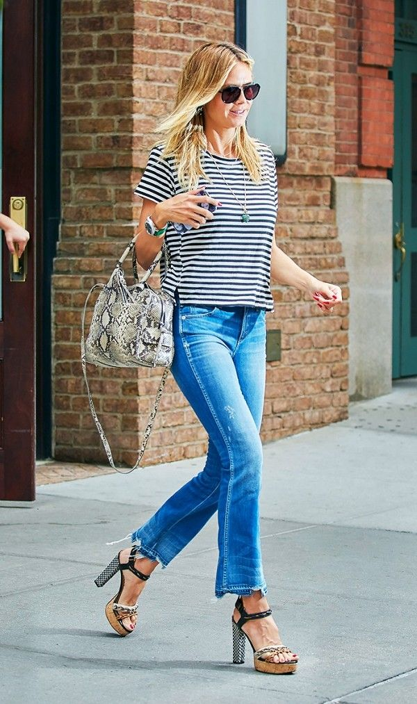 c3ec4ffa0cc4 Heidi Klum elevates her striped tee and cropped flare jeans with platform  ankle strap heels.