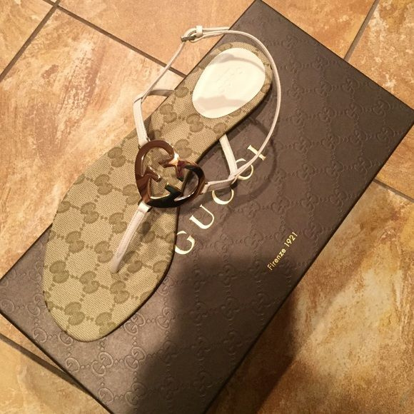 172cc8af7 NWT Gucci leather interlocking G flat sandal cream Never used perfect  condition in mystic white color. Signature g logo with gold heart shaped g  on front.