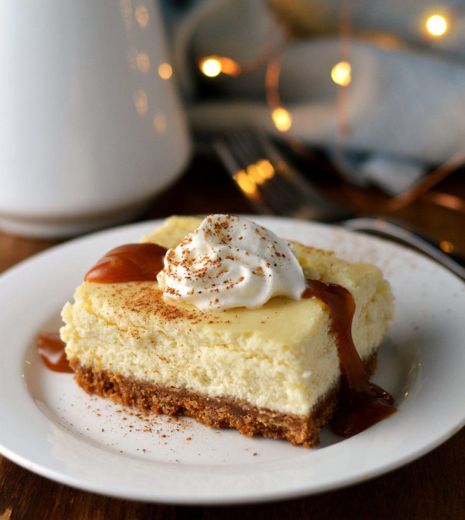 Eggnog cheesecake bars with caramel rum sauce #eggnogcheesecake