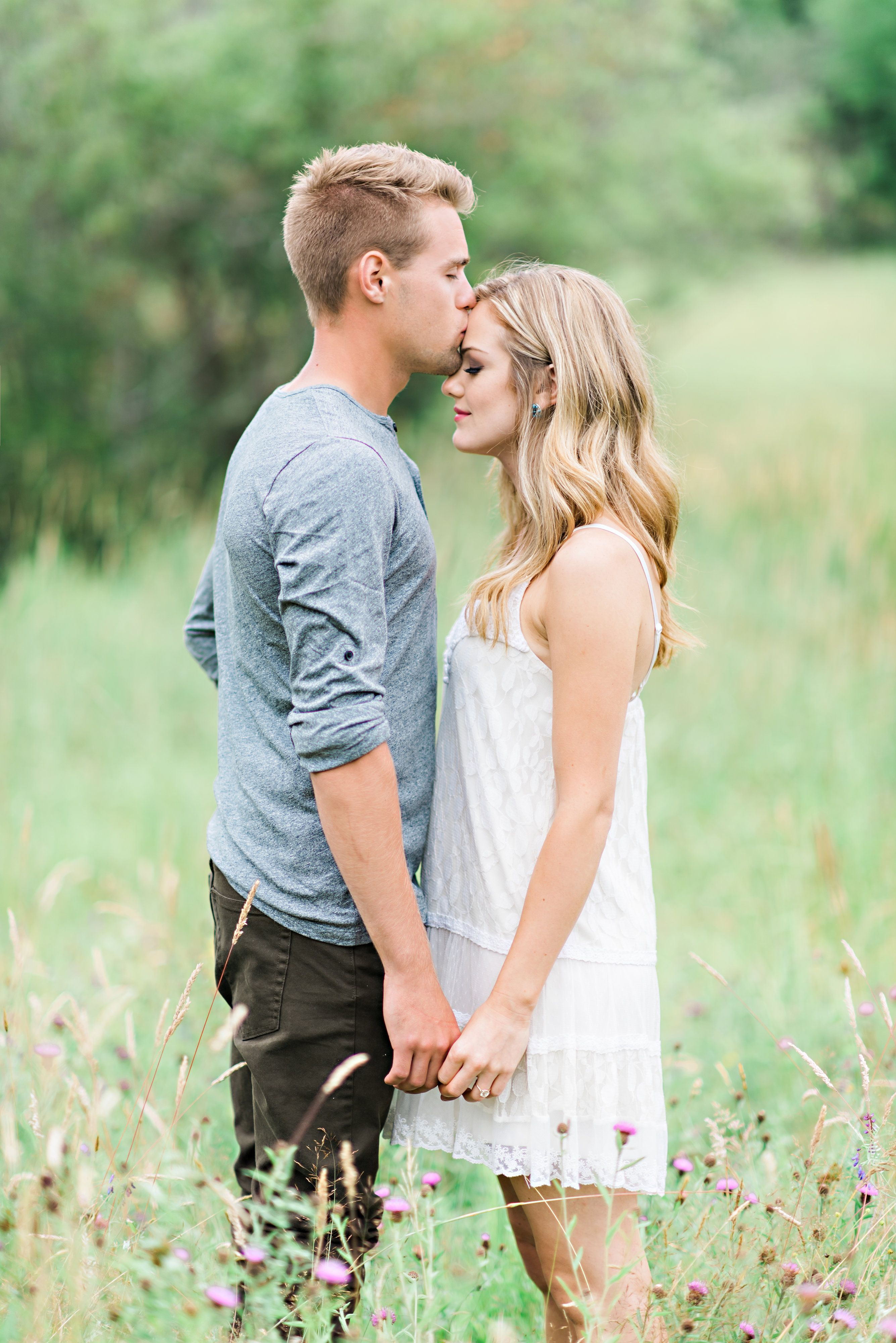Blonde Couple In Field on their Whimsical Outdoor Engagement Shoot