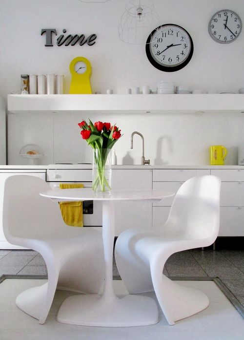 Playful white kitchen with multiple clocks & a dash of the literal