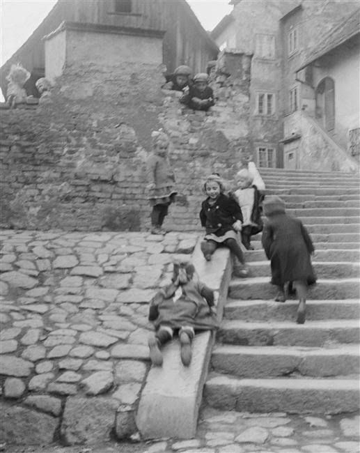 André Kertész i chose this photo because it shows at this time kids would make the best of stuff and used the side of stairs as a play set.