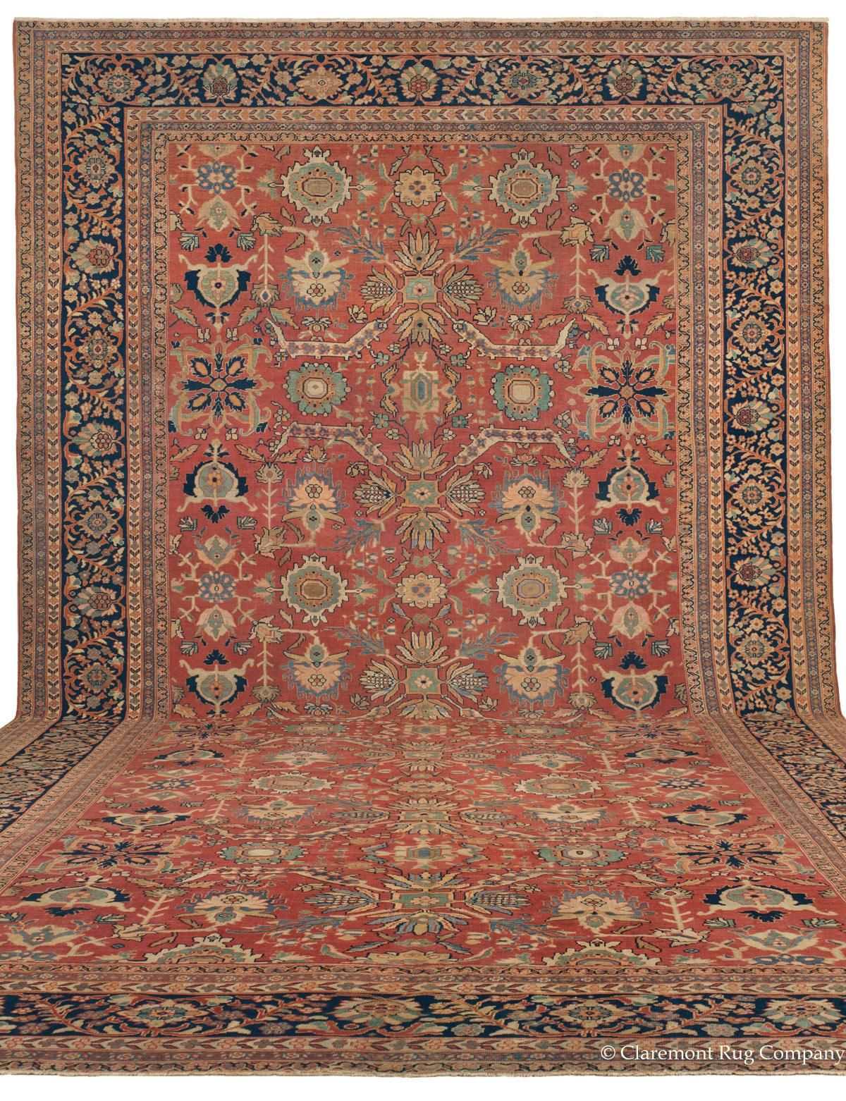 Sultanabad, 13ft 3in x 24ft 3in, Circa 1875. Possessing all the most desired attributes of the ever-beloved Sultanabad weaving group, this 19th century palace-size carpet brings a stunning visual impact to its massive proportions. The soft, welcoming coloration of this luxurious carpet, the result of nuanced, expertly chosen natural dyes and the inimitable patina of substantial age, imparts luminosity to every inch of its expansive allover design, enveloping the viewer in harmonious hues.