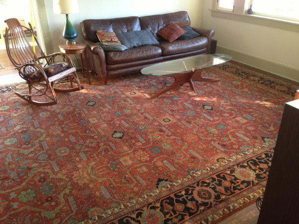 An Oversize Rug Fills A Rectangular Living Room Interiordesign