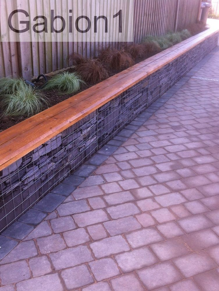 Small gabion retaining wall and timber capping httpwwwgabion1