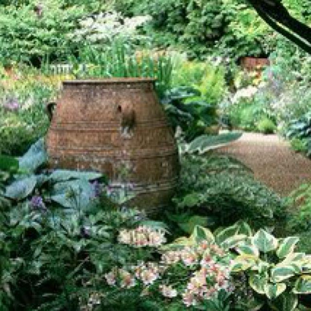 Urn As A Focal Point In This Lovely Woodland Garden Rustic Garden Design Front Yard Landscaping Garden Design