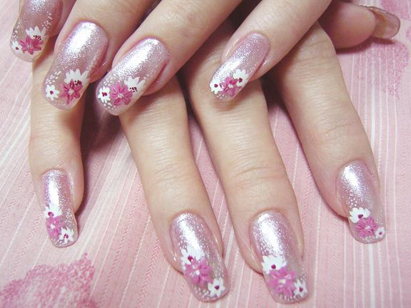 Pink nails with flowers on them