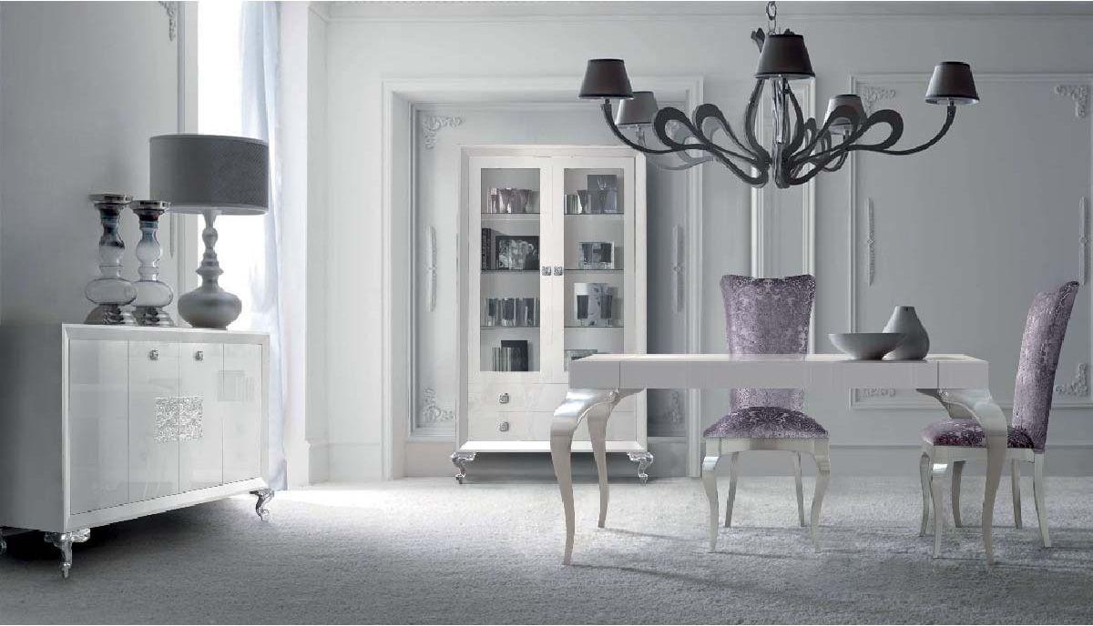 Comedor con muebles lacados en blanco alto brillo y plata Comedores altos modernos