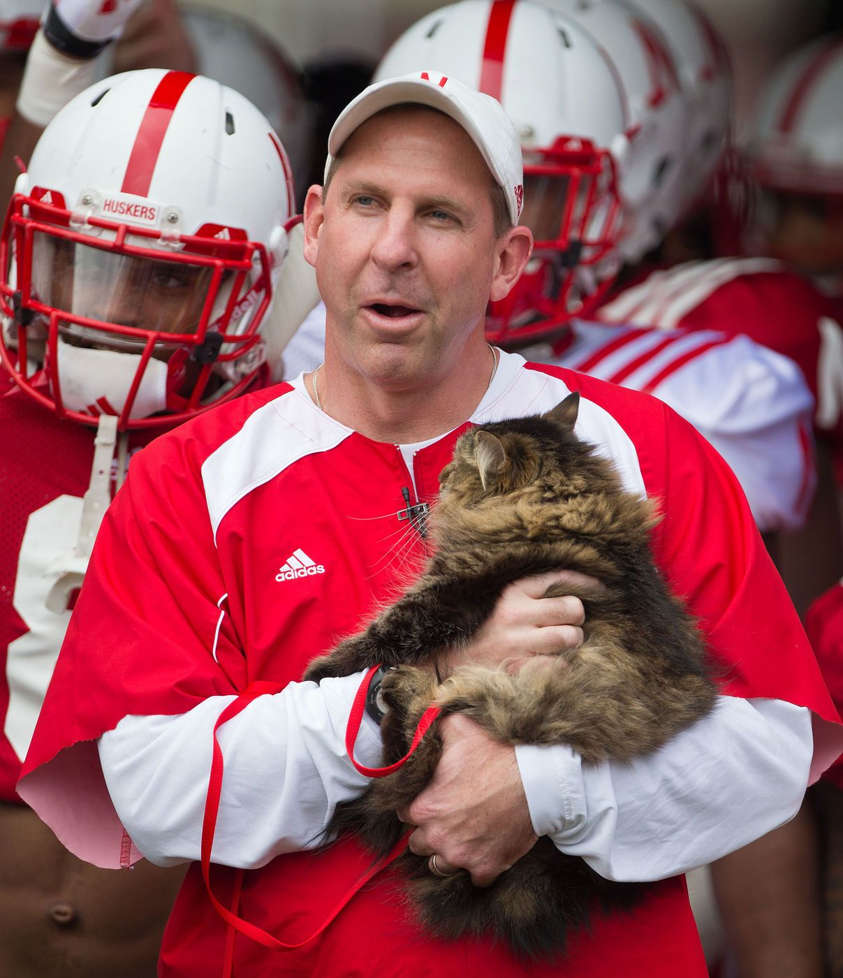 Bo Pelini and his cat before the Husker spring game on ...