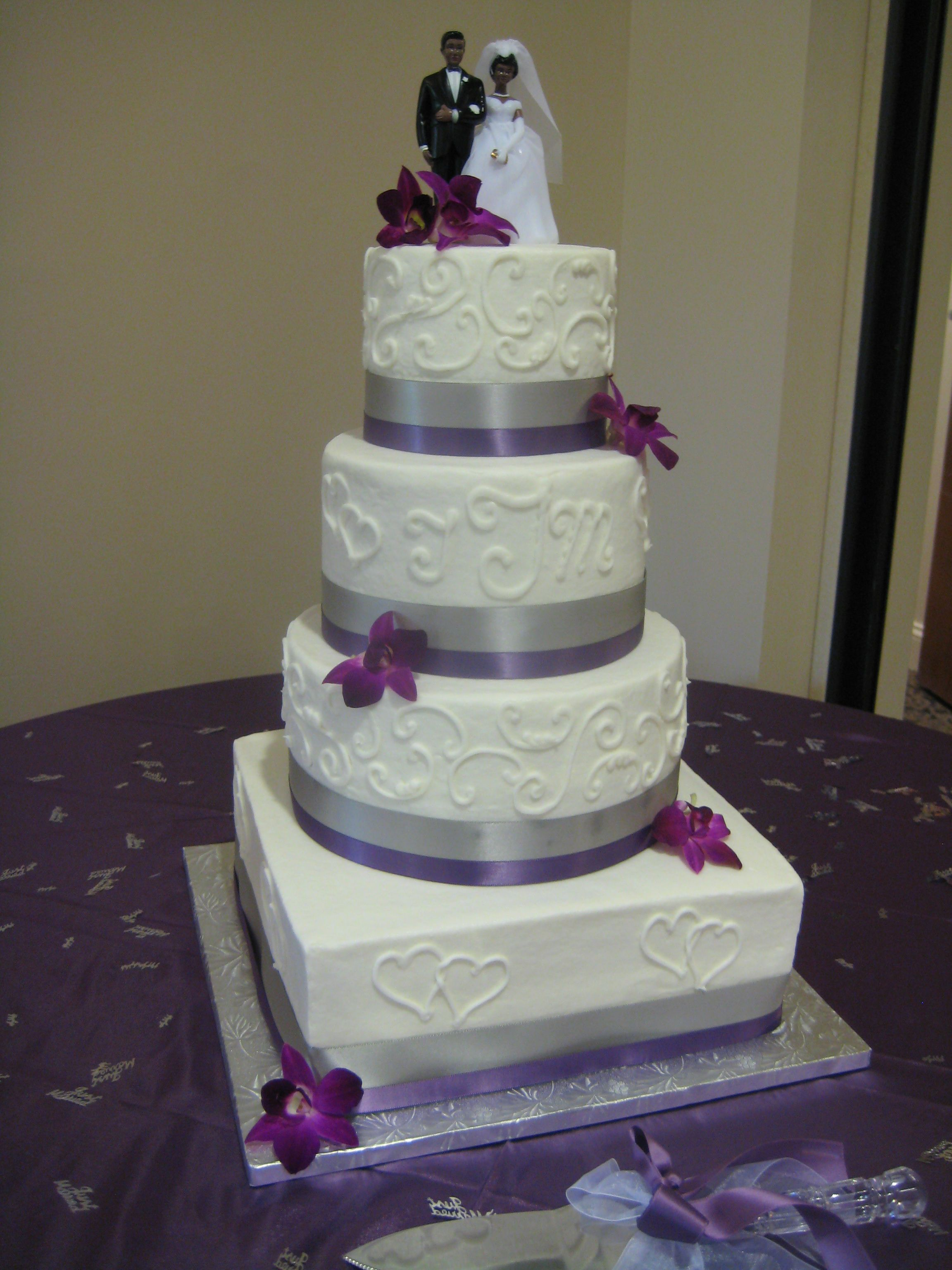 Four tier square and round wedding cake with purple and gray ribbon ...