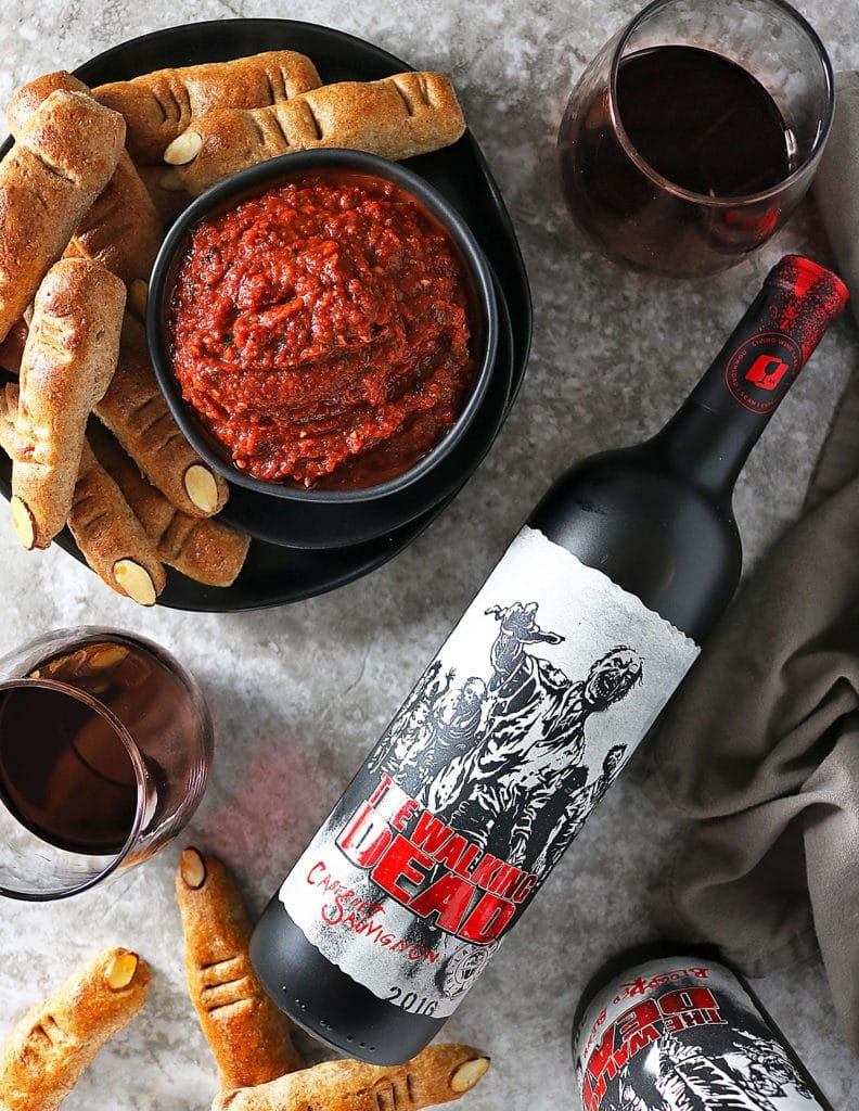 Overhead Dead Finger Breadsticks And Red Pepper Red Wine Dip And A Bottle Of Living Wine Labels Red Blend Roasted Red Peppers Breadsticks Pinterest Recipes