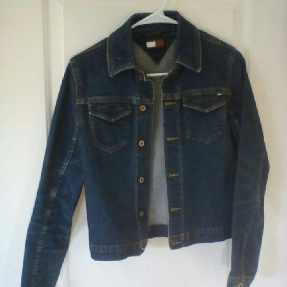 """Jean Jacket- Tommy Jeans small This comfy jean jacket is just what you need for spring and summer. Brand is tommy jeans size small (fit runs small).It is in used condition.  It has two usable front pockets,  copper color button details, minor snags in fabric (see pics) and wear. Fabric is a stretchy denim with 98%cotton and 2% spandex. Shoulder to hem 21"""", sleeves 22"""" across chest  14"""" (alll measurements approx) Tommy Hilfiger Jackets & Coats Jean Jackets"""