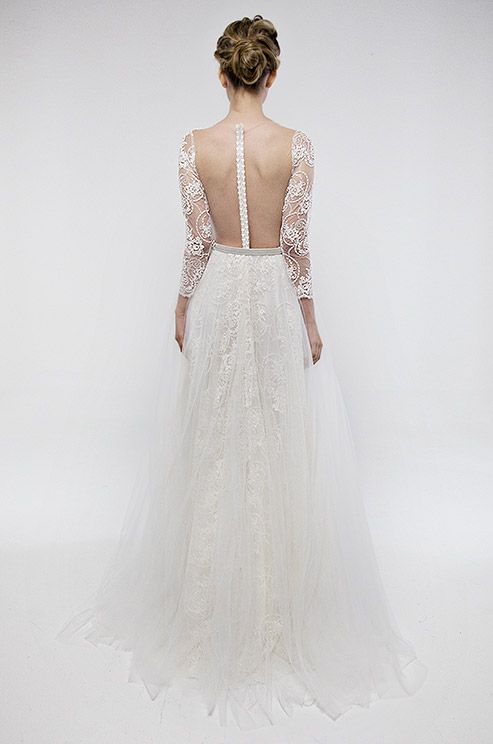 We love the chic illusion back of this Francesca Miranda wedding dress.