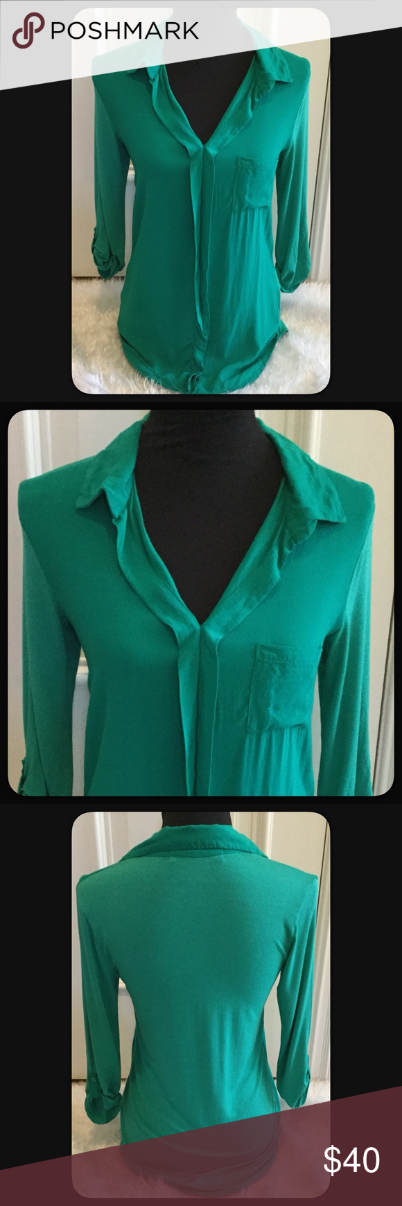 """🆕Vintage Havana Green Top Pretty two tone Kelly green top by Vintage Havana. The front, collar & tabs on sleeves are a Kelly green, the back and sleeves are a shade or two lighter. Super soft & comfortable. Looks great with leggings, jeans, shorts, skirts. Measures approximately from center 27"""" front 29"""" back, the sides about 23""""-24"""" long. Armpit to armpit 17"""" across. Pretty soft top. EUC. Worn twice. Material 100% Rayon. From Bloomingdales. Made in NYC. Vintage Havana Tops Blouses"""