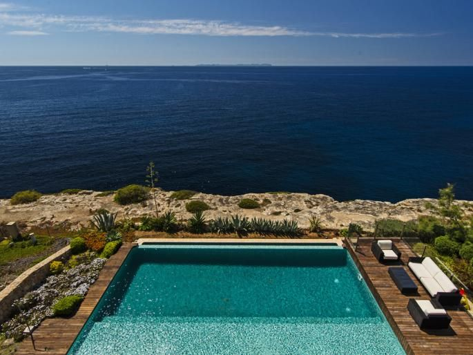 Best located pool adjacent to bright and modern frontline villa in Cala Pi…