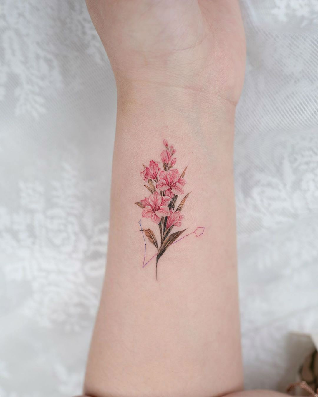 27 Graceful Gladiolus Tattoos And What This Beautiful Flower Symbolizes In 2020 Gladiolus Tattoo Lilly Flower Tattoo Tattoos