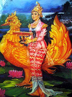Goddess Saraswathi represented in Bamar fashion, sitting on her hamsa, holding the scriptures in her hand.