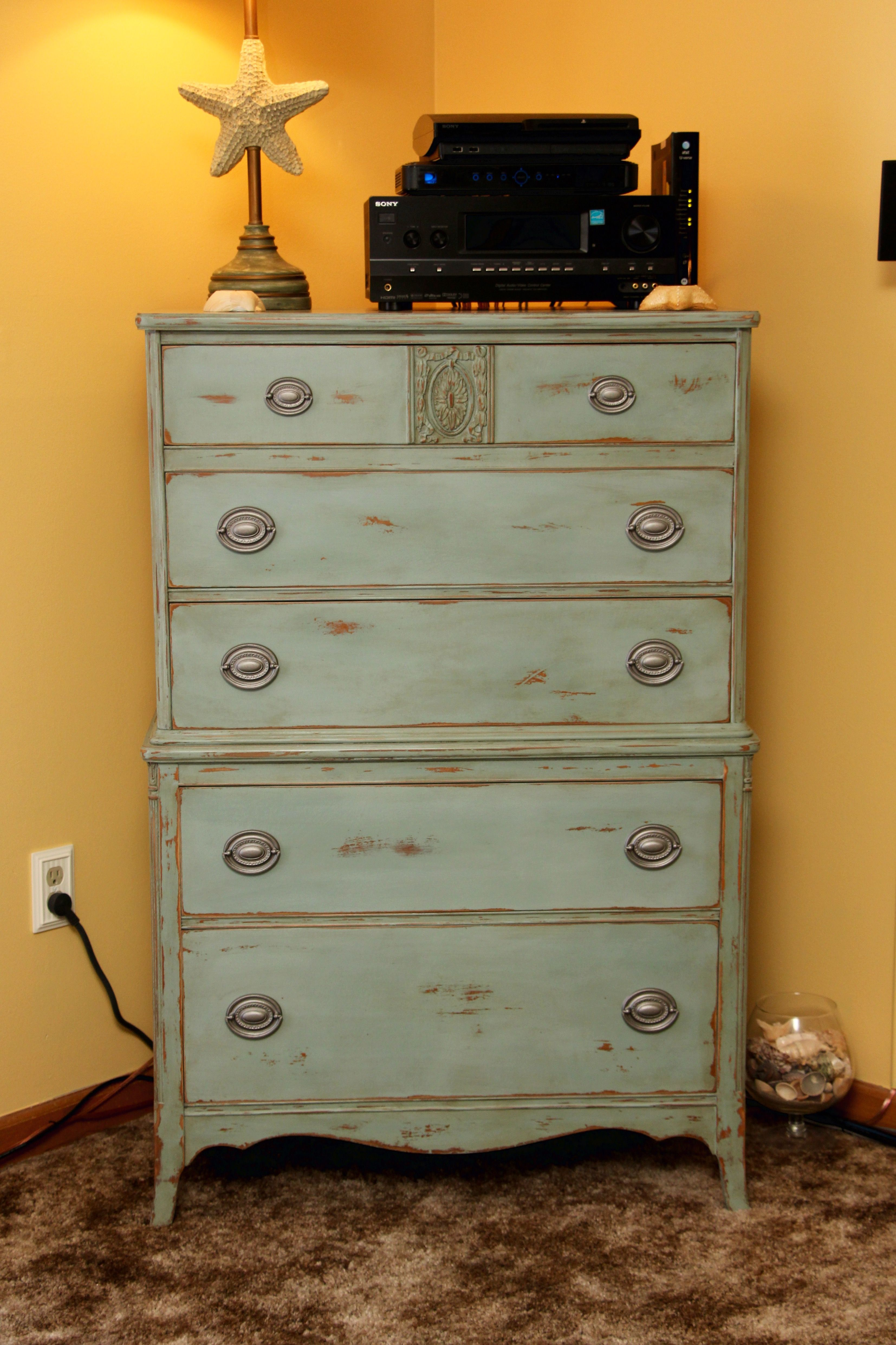 This Tall Boy chest of drawers is painted in a Duck Egg Blue and is