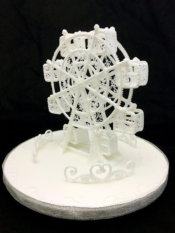 Icing Wheel topper by Grazie cake and sugarcraft studio ...