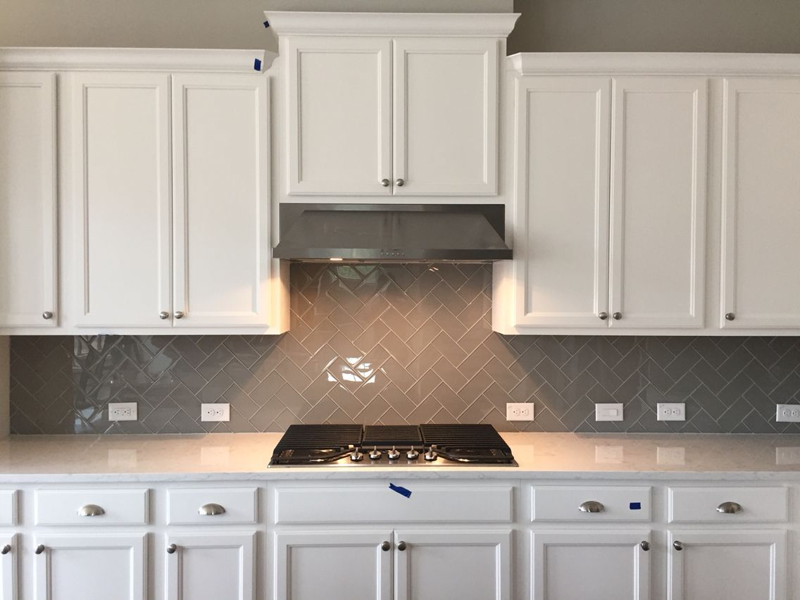 - 3x6 Morning Fog Glass. Herringbone Pattern. Quartz Kitchen