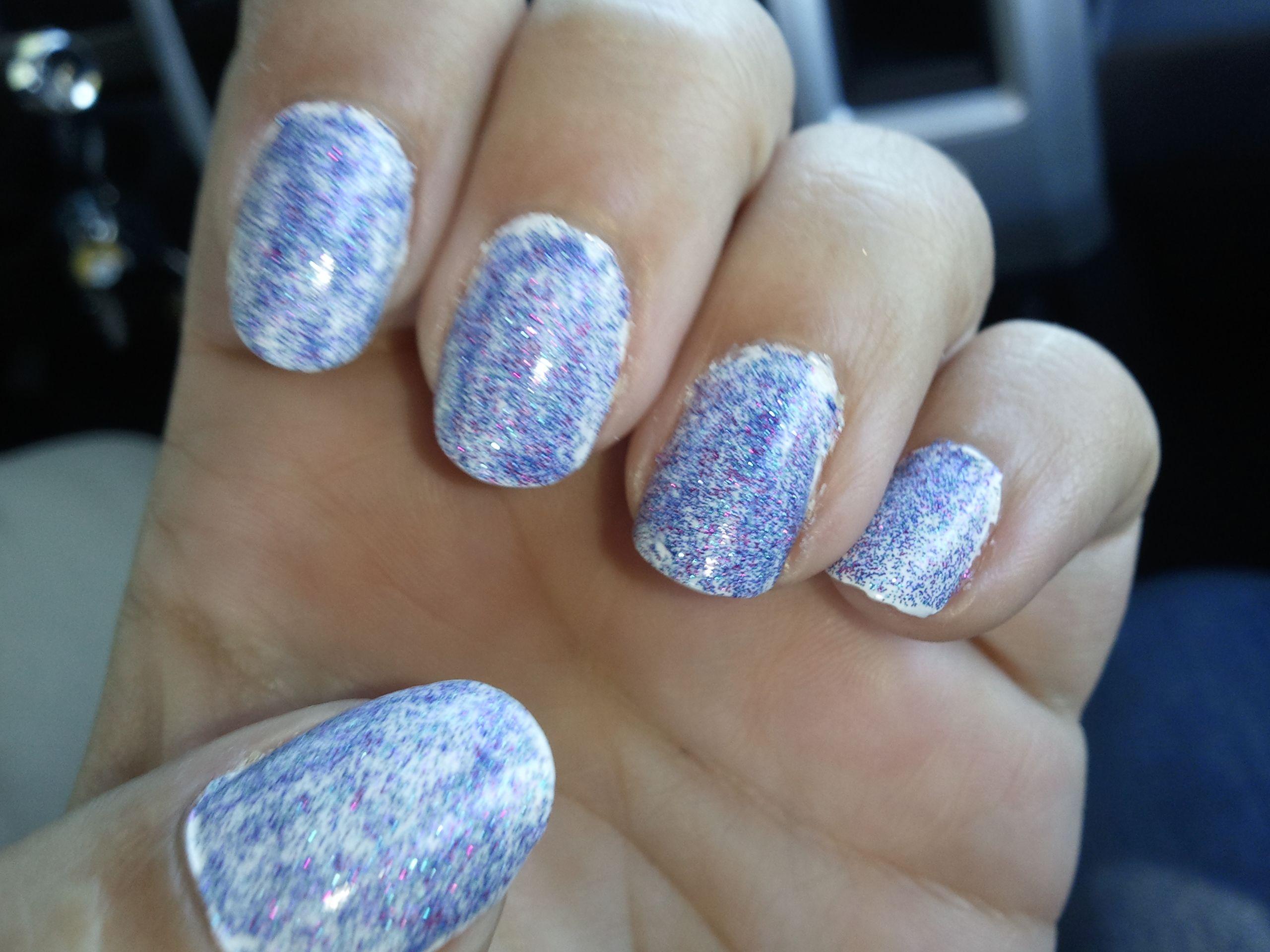 white nail polish (2 coats) purple and blue glitter polish (1 coat