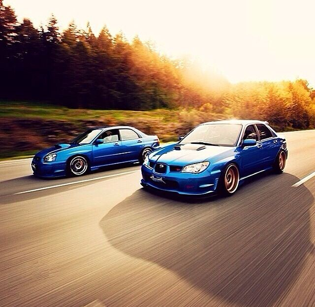 Two Subarus riding side by side