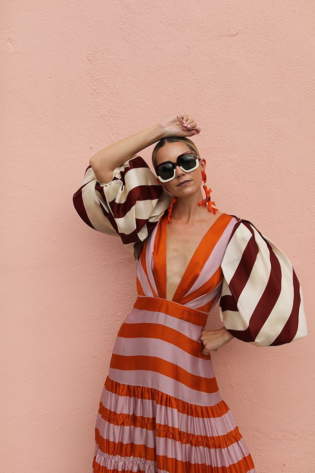 Seeing stripes // Blair Eadie wearing a striped dress and bolero, both by Johanna Ortiz // Sunglasses by Carolina Herrera and earrings by Dinosaur Designs