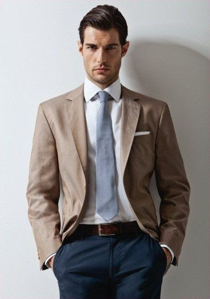 Navy pants. Tan blazer? And gray blue tie! Against stark white ...