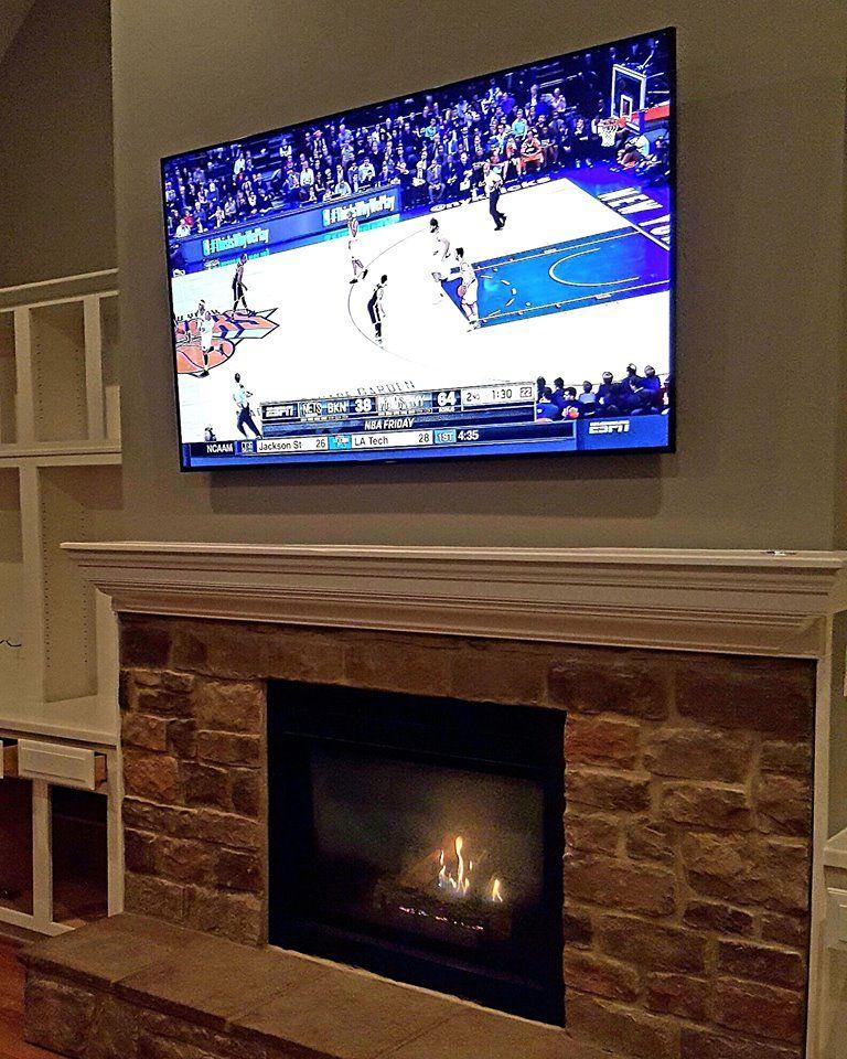 75 Samsung 4k Smarttv Wall Mounted Above Fireplace Logitech
