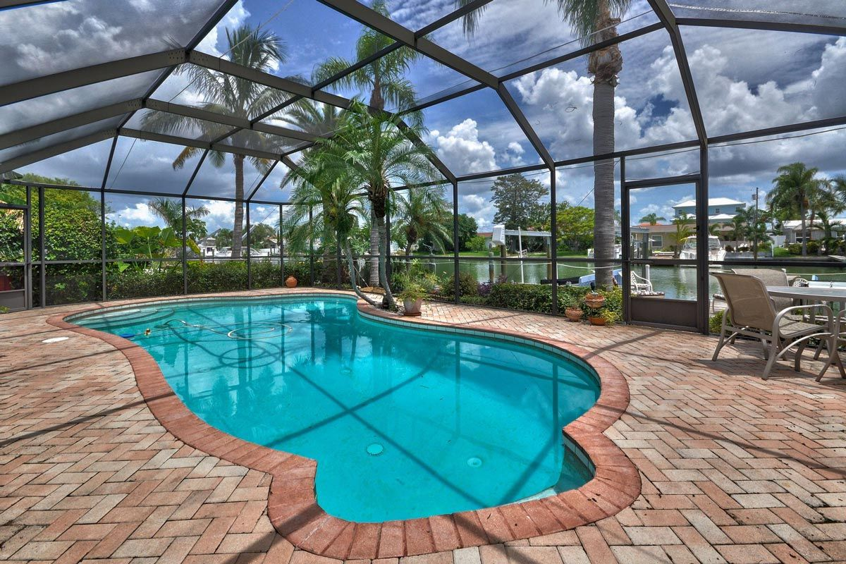 Pool Screen Enclosure With Mansard Roof Installed Over Pavers Near Lake In 2021 Fancy Houses Dream Backyard Backyard Pool