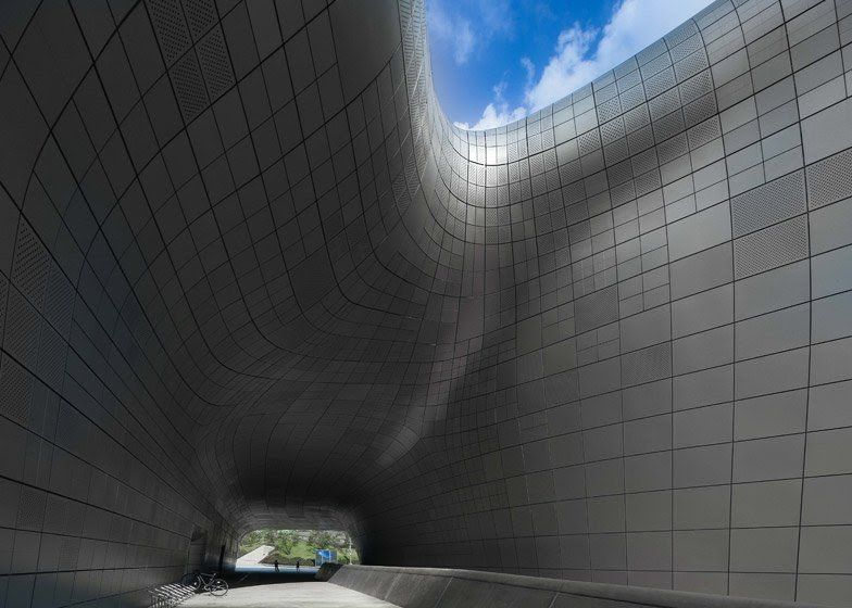These new images capture the undulating contours and glittering surfaces of Zaha Hadid's Dongdaemun Design Plaza complex in Seoul, South Korea.