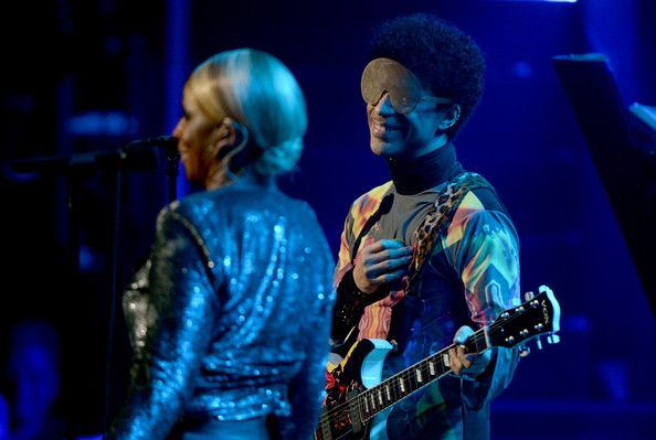 Prince Photos - Musician Prince (R) and singer Mary J. Blige perform onstage during the 2012 iHeartRadio Music Festival at the MGM Grand Garden Arena on September 22, 2012 in Las Vegas, Nevada. - 2012 iHeartRadio Music Festival - Day 2 - Show