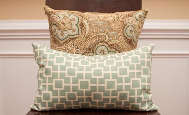 no zipper envelope pillow tute- basic sewing is all that is required and you can make pillow covers to use throughout the seasons, holidays or even just as your taste in fabric changes- you can fold them away like linens when not in use covering your pillows!